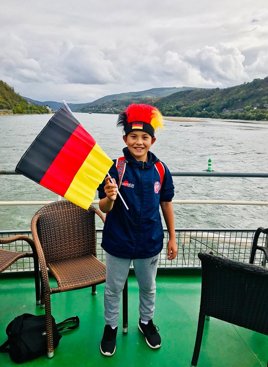 Student with German flag boat ride