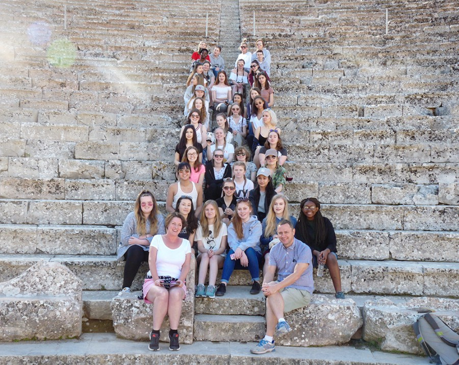Students and teachers on steps Greek theatre